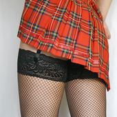 Up-skirt image on lady in black stockings — Stock Photo