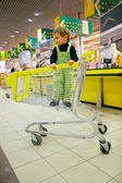 Boy in supermarket — Stock Photo
