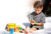 Young boy painting outdoors partly isolated over white — Stock Photo