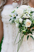 Close up of wedding bouquet in bridal hands — Stock Photo