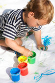 Young boy painting over white — Stock Photo