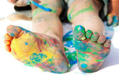 Colored child's feet over white — Stock Photo