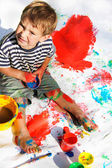 Cute boy painting over white — Stock Photo