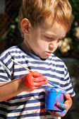 Young boy ready to paint outdoors portrait — Stock Photo