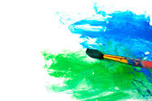 Drawing a picture with paintbrush in green and blue — Stock Photo