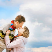 Young loving couple over sky background — Stock Photo