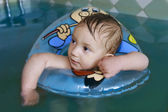 Baby boy in water pool — Stock Photo