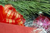 Gift box, christmas ball and silver tinsel — Stock Photo