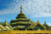 Buddhist temple on bright sky background — Stock Photo