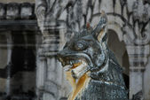 Old sculpture on blurred background — Стоковое фото