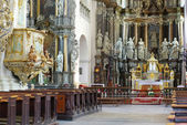 Cathedral interior with altar and seats — Stock Photo