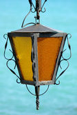 Old lamp on sea background — Stock Photo