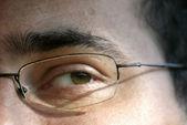 Close-up van oog en glazen — Stockfoto