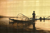 Fishermen on old papirus paper — Stock Photo