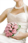 Wedding bouquet in bride — Stock Photo