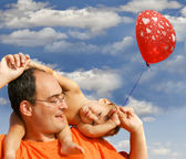 Father and son on sky background — Stock Photo
