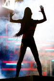 Dancing girl in night club — Stock Photo