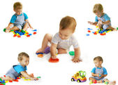 Playing baby-boy over white collection — Stock Photo