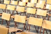 Wooden chairs aligned at outdoor school event — Stock Photo