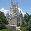 Cinderella's Castle Standing Proud Under Blue Sky at DIsney World Orlando - Stock Photo