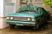 Oldtimer Standing still, protected from rain and foliage — Stock Photo
