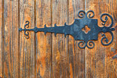 Wooden fence with wrought iron — Stock Photo