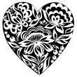 Silhouette of the heart and flowers on it. Black-and-white image. Old style — Imagen vectorial
