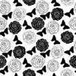 Seamless background with monochrome black and white butterflies and roses. — Stock Vector #43174943