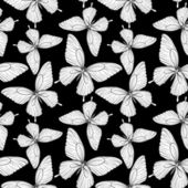 Seamless background of butterflies black and white colors. — Stockvektor