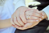 Hands of pair with a beautiful wedding ring — Stock Photo