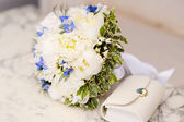 Wedding bouquet of white peonies — Stock Photo