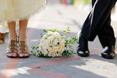 Groom and bride with bouquet — Stock Photo
