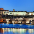 Charles Bridge and Prague castle by night - Stock Photo