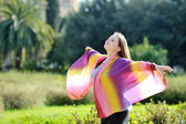 Woman relaxing with open arms and face to sun — Stock Photo