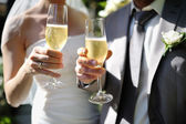 Bride and groom making a toast with champagne — Stock Photo