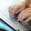 Male hands typing on a laptop pc keyboard — Stock Photo