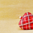 Heart shaped Christmas tree decoration on golden background — Stock Photo