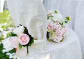 Beautiful wedding bouquet on a white chair — Stock Photo