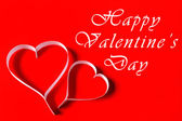 Happy Valentine's Day - white paper hearts on red background — Stock Photo