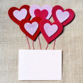 Blank Valentines card with red hearts — Stock Photo