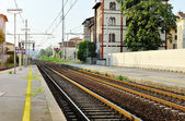 Train station and steel railway tracks, Italy — Stock Photo