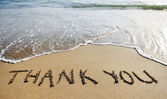 Thank you word drawn on the beach sand — Stock Photo