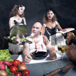 Young girls serving raw pork to a fat man — Stock Photo