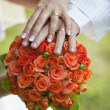 Stock Photo: Couple Hands on Bridal Bouquet
