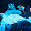 Young couple sleeping on a boring movie  — Stock Photo