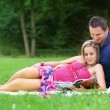 Pregnant woman with his husband in park — Stock Photo