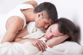 Gay couple kissing on the bed — Stock Photo