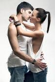 Passionate heterosexual couple in studio — Stock Photo