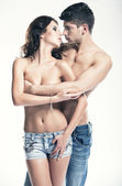 Passionate heterosexual couple in studio — Stock Photo