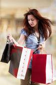 Beautiful young women shopping — Stock Photo